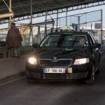 CDG airport black taxi arriving at the airport