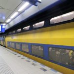 Amsterdam airport double-deck train waiting on the platform