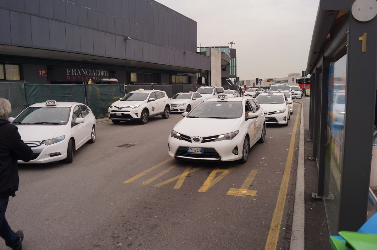 Bergamo airport white taxis lined up