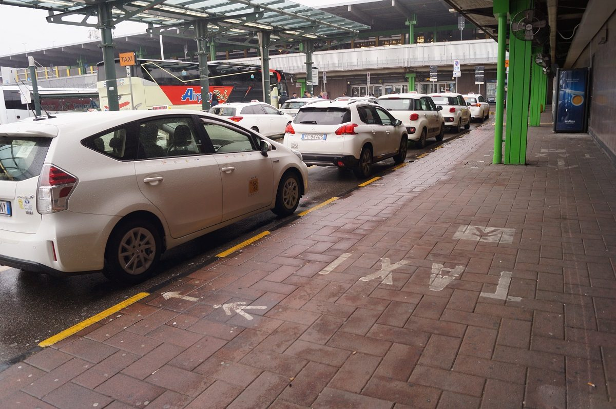 Linate airport white taxis lined up