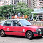 single urban red taxi at hong kong airport