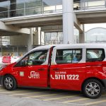 urban red single taxi van at hong kong airport