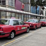 urban red taxi line up at hong kong airport