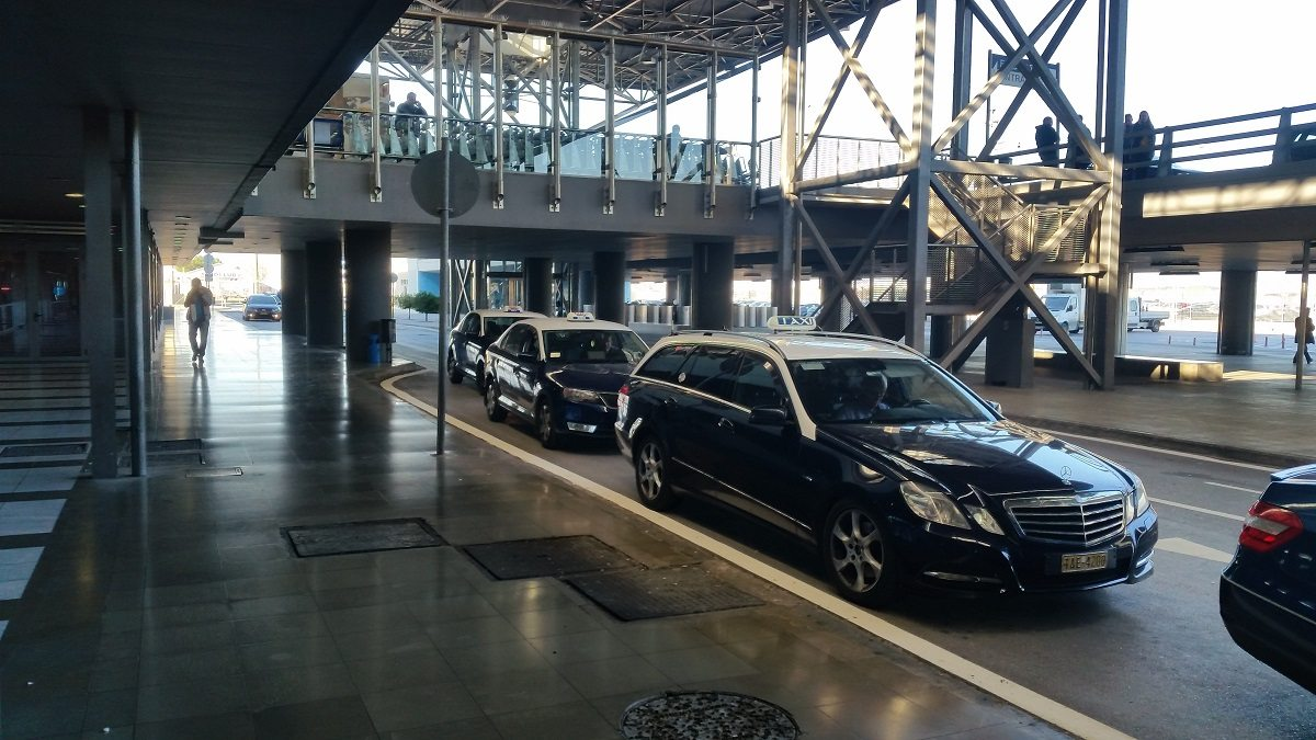 Macedonia airport blue taxis on the line