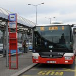 Public bus No. 100 waiting on the platform