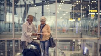 senior couple looking at documents in airport
